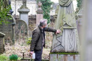 looking at gravestone